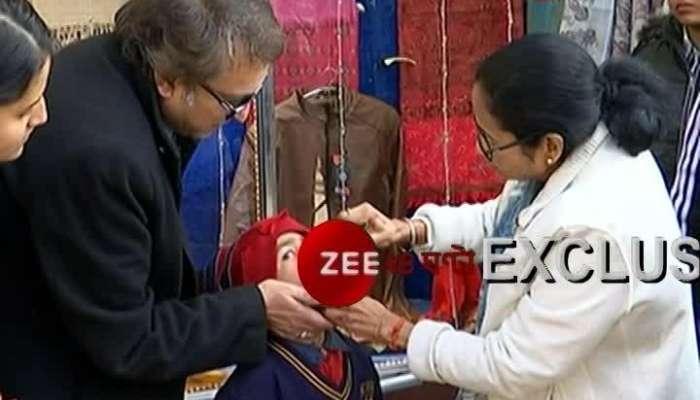 Mamata Banerjee gives anti-Polio drops to little kids at Darjeeling